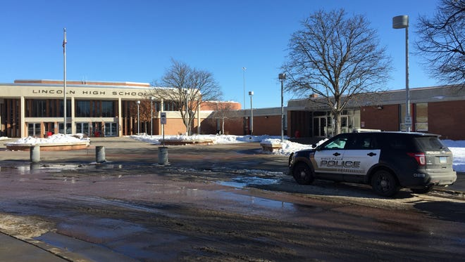 A Sioux Falls Police vehicle sits outside Lincoln High School on Thursday, Jan. 14, 2016.
