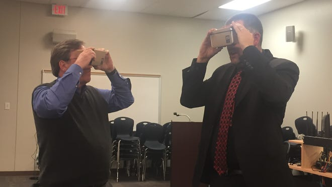 Williamson County school board members Rick Wimberly, left, and Ken Peterson use Google Cardboard, a virtual reality app.