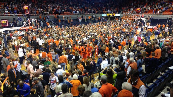 Auburn fans stormed the court after the Tigers upset No. 14 Kentucky 75-70 Saturday.