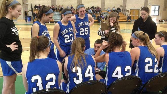 Pearl River head coach Chris Woolgar talks to his team during a timeout at Saturday's Autism Classic at Irvington High School. Jan. 16, 2016.
