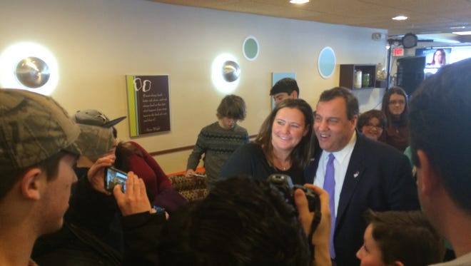 Chris Christie poses for photos with supporters Monday, Jan. 18 in Council Bluffs.