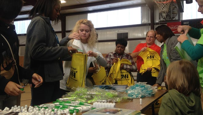 Volunteers pack disaster relief kits for the MLK Day of Service.