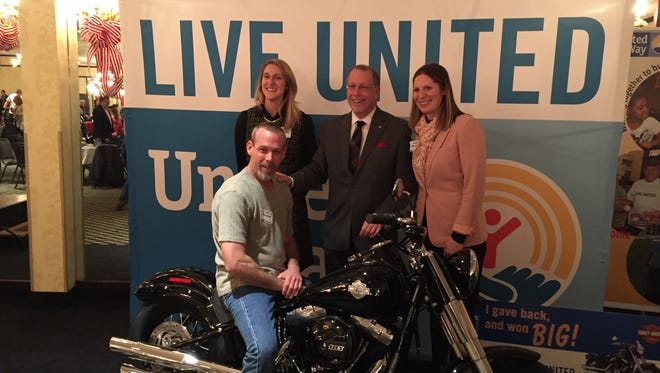 Troy Creakman, of Red Lion, sits on his new motorcycle after winning the grand prize at United Way's 2015 Campaign Celebration, Tuesday, January 19, 2016.
