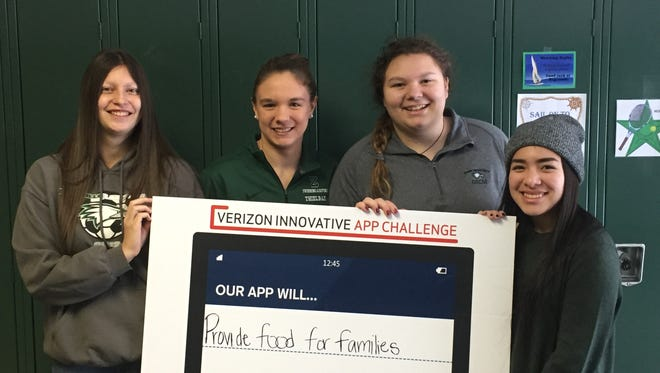 Zionsville High School students Violet Dusek, Jordan Thielbar (from left), Abby Robinson and Courtney Matkovic won $5,000 in the Verizon Innovative App Challenge. Shelby Paden (not pictured) also was part of the app team.