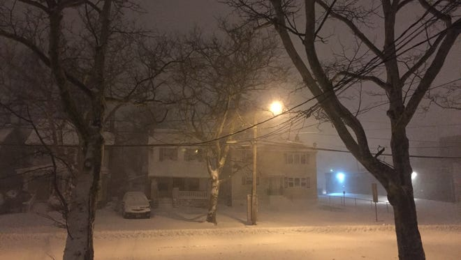 Snow continues to fall in Asbury Park at about 6 a.m. Saturday.