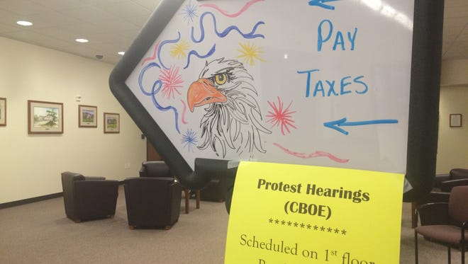 A sign at the Larimer County Courthouse during property valuation protests last year.