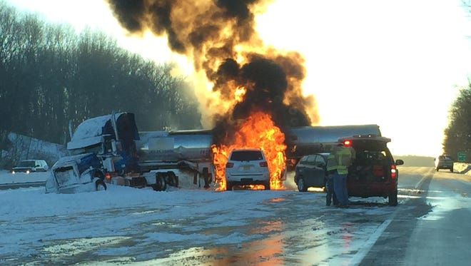 An SUV burst into flames after colliding with a jack-knifed tractor trailer on Rt. 80 west, Sunday, Jan. 24, 2016, according to N.J. State Police. A second SUV also struck the truck. Both drivers and a passenger escaped with minor injuries.