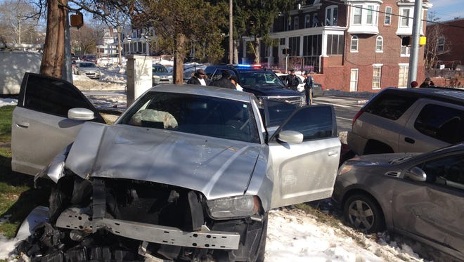 Shortly after Wilmington police stopped pursing a stolen vehicle Wednesday, it crashed into two parked cars.