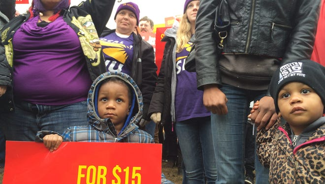 Jayvin, 2, and his twin sister, Jaylin Wiggin stood with their mother outside a Des Moines McDonalds during the Fight for 15 protest.
