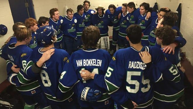 Members of the Wisconsin Rapids Riverkings hockey team celebrate a successful weekend last week.