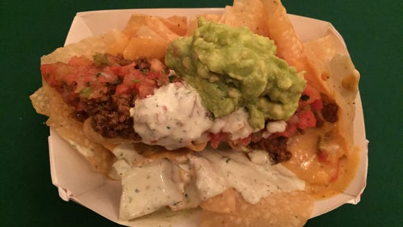 Chuy's happy hour includes a complimentary, fully loaded nacho bar.