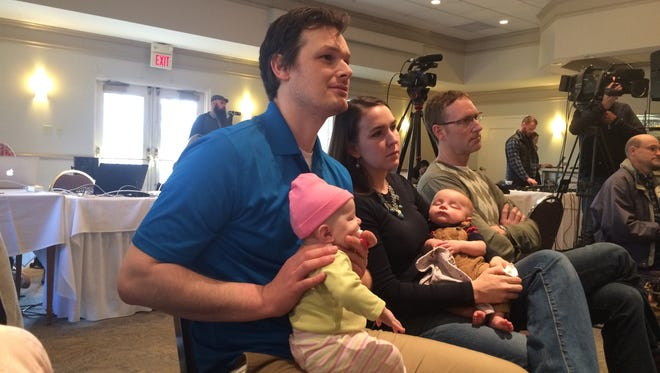 Abraham and Erin Sheffield hold their 16-week-old twins Hugh and Greta at a Chris Christie town hall near Iowa City.