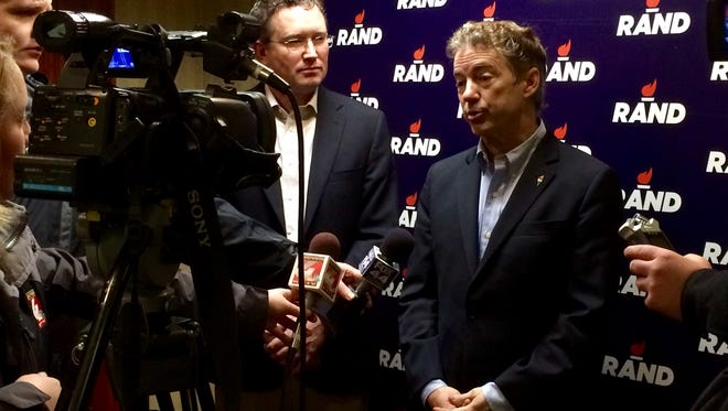 Sen. Rand Paul and Rep. Thomas Massie, R-Ky., speak to the media in Sioux City. Massie will stump for Paul throughout Iowa through caucus night.