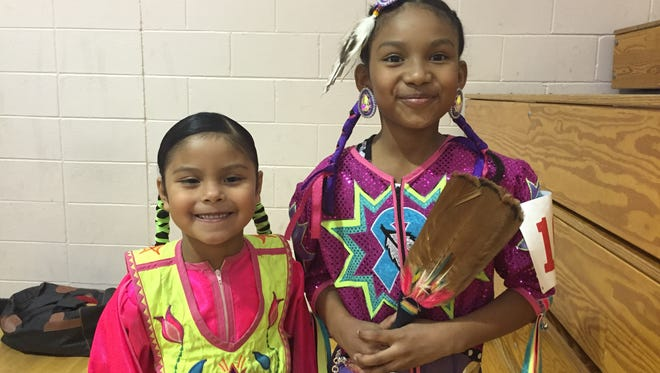 Aniya San Miguel,6,  and Aubrianna Torres, 9, prepare to dance at the Alabama-Coushatta Children's Pow Wow.