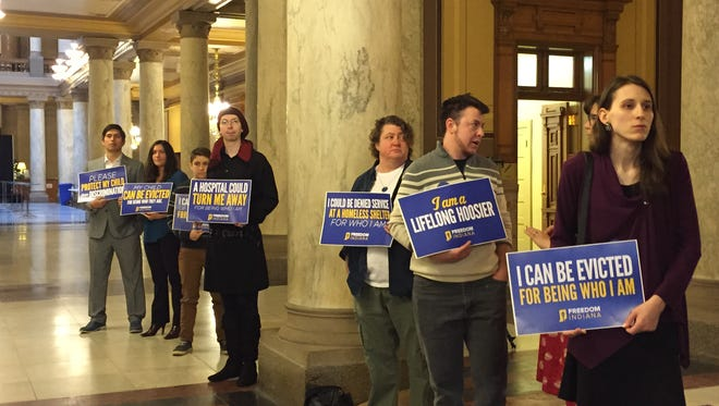 Supporters of transgender rights greeted lawmakers as they entered the Indiana Statehouse on Monday.
