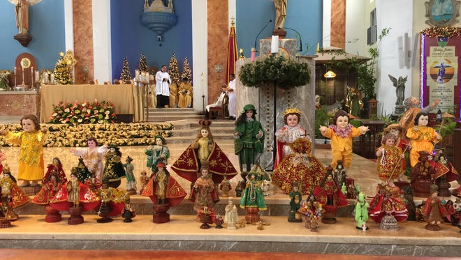 Hundreds of island residents attended a Mass as part of the Santo Nino fiesta celebration on jan. 10. Many brought their statues of the infant Jesus to display.
