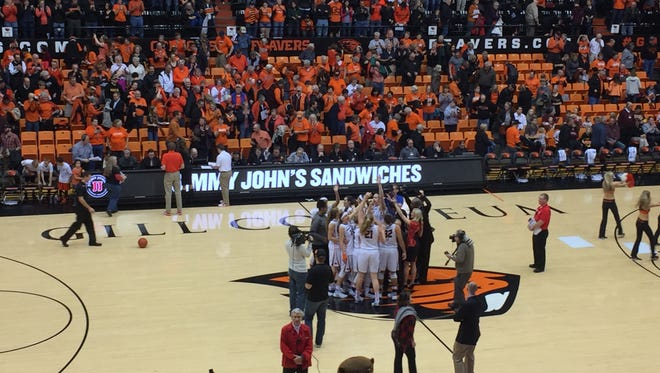 Oregon State players celebrate at halfcourt after a 67-44 victory over Arizona State at Gill Coliseum on Feb. 1, 2016