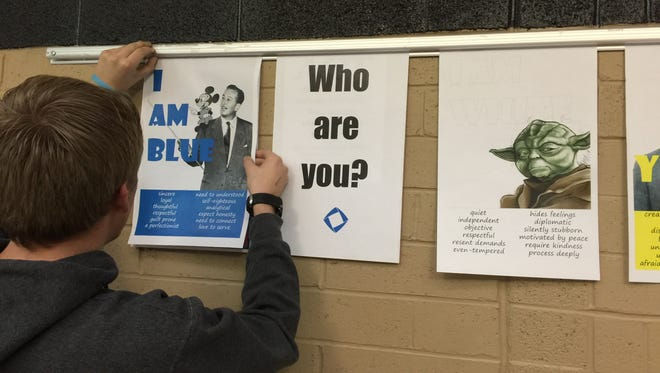 Pine View High School senior Joseph Brimer  looks at one of the campaign displays that shows the different characteristics/qualities of the color code.