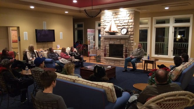 Phil Rockwell talks about his alcohol addiction and recovery to a group of people at CenterPointe Marina Club House on Jan. 28