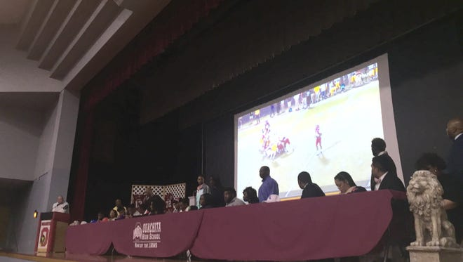 Eight players from the Ouachita High School senior class signed a National Letter of Intent during a ceremony in the school auditorium Wednesday.