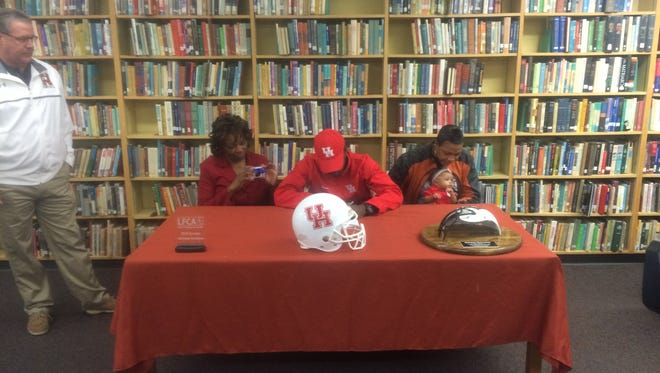 Northwood wide receiver Marquez Stevenson signs to play football at Houston Wednesday morning.