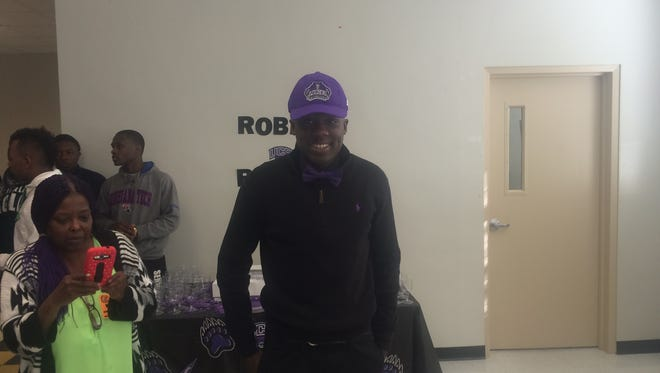 Fair Park's Robert Rochell celebrates signing to play football at Central Arkansas on Wednesday.