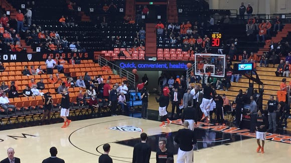 Oregon State warms up before its game against Utah on Thursday at Gill Coliseum.
