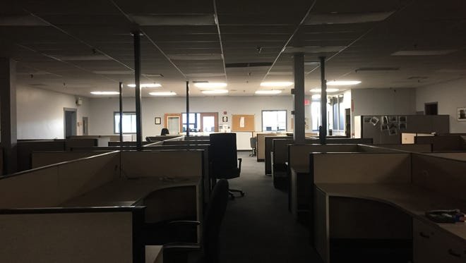 The Courier-Post moved its newsroom across the building. A darkened room with empty desks remains.