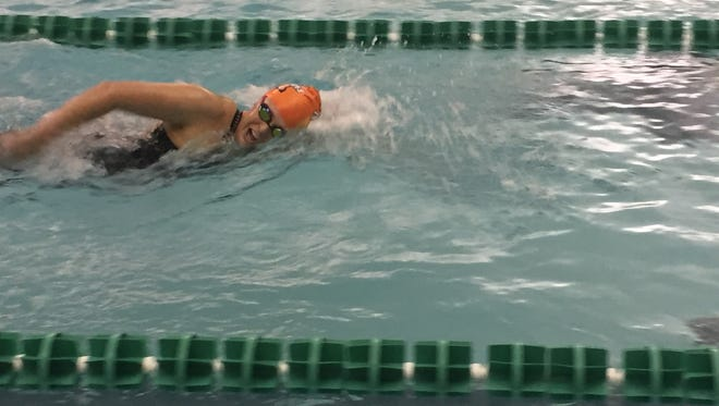 Harrison's Annie Lee swims to a fifth-place finish in the 500-yard freestyle at the Zionsville Sectional.