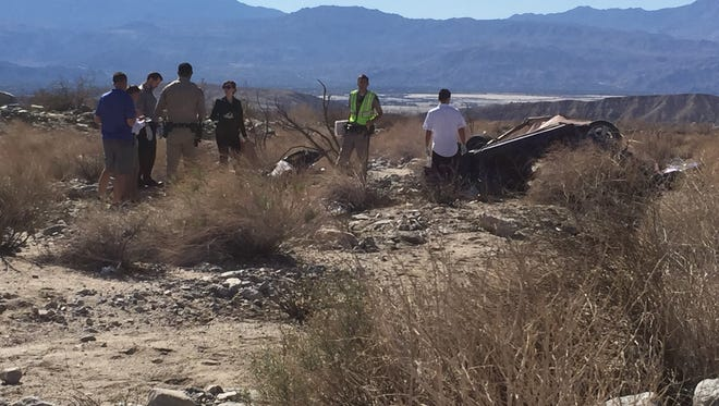 California Highway Patrol officers and officials from the Riverside County Coroner's Officer investigate a rollover accident that left one dead and one with major injuries Saturday morning on Dillon Road east of Thousand Palms Canyon Road.