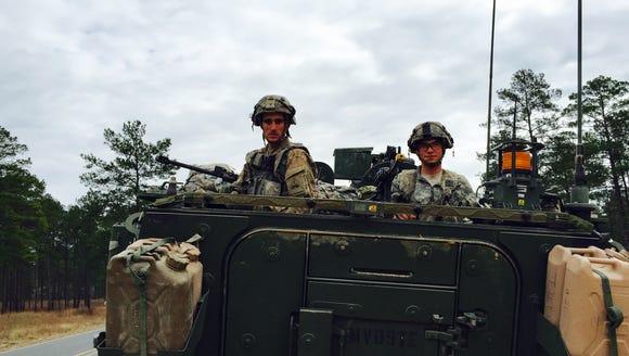 Sgt. Dallas Reynolds, left, of Savannah, Ga., and Spc.