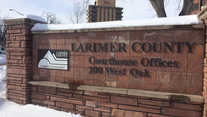 The sign in front of the Larimer County Courthouse Offices.