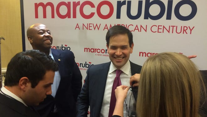 Florida Sen. Marco Rubio gets ready to talk with reporters at the Spartanburg Marriott Wednesday with South Carolina Sen. Tim Scott by his side.