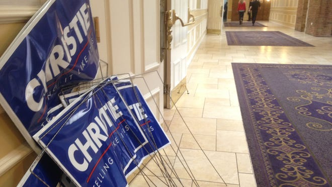 Campaign signs sit in the hallway outside the ballroom where Gov. Chris Christie held his election night event in Nashua, N.H.