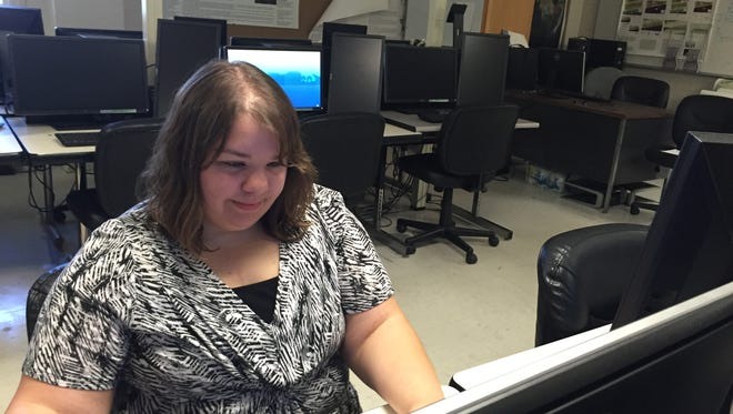 Pensacola Pledge Scholarship recipient Haley Anderson, a UWF senior, works on an assignment for her remote sensing aerial photo interpretation class Wednesday in the computer lab.