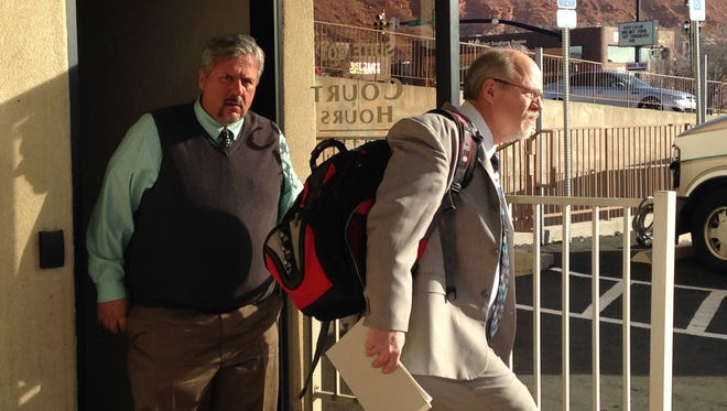 Varlo Davenport, left, and defense attorney Aaron Prisbrey leave the Washington County Justice Court building following a February hearing. Davenport, a former Dixie State University professor, is charged with misdemeanor assault for allegedly pulling a student's hair in class.