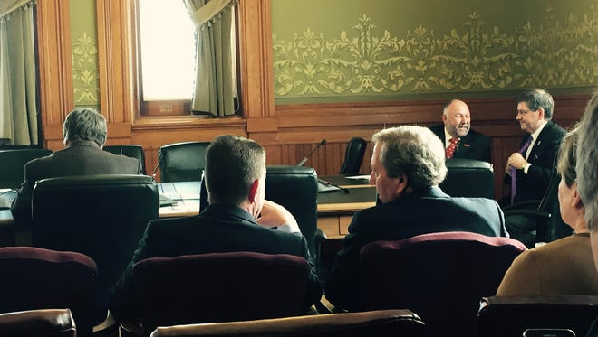 Bruce Harreld, right, president of the University of Iowa, speaks with Bruce Rastetter, left, president of the Iowa Board of Regents, before the Thursday, Feb. 11, 2016,  meeting of the Education Appropriations Subcommittee at the Statehouse in Des Moines. Iowa State University President Steven Leath and University of Northern Iowa President William Ruud sit in the background.