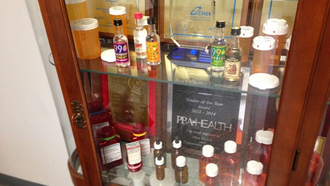 A few of the products manufactured by Berry Plastics are on display at the entrance of the Jackson facility at 1005 Lower Brownsville Road.