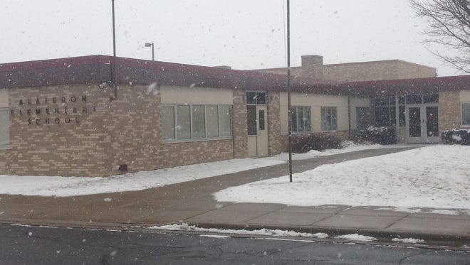 Snow begins to fall Friday at Alaiedon Elementary School in Alaiedon Township. One sink at the facility was found to have an unacceptable lead level, and Mason Public Schools officials replaced the faucet. and are awaiting the results of a second test. The students in that classroom are receiving bottled water.