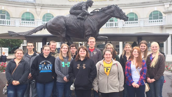 Fourteen members of the Beaver Dam FFA chapter recently attended the National FFA Convention in Louisville, Kentucky. Front row, left to right, Brandi Strahota, Kelley Braun, Emily Roeder, Tori Walter, Kaitlin Bunker, Rachel DesJardins and Alexis Lins. Back row, left to right, Colin Zimmerman, Cody Scott, Andy Boschert, Ryan Christian, Rhianna Van Loo, Jennifer Swan and Alexis Luedtke.