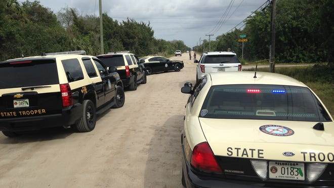 Authorities investigate at the scene of a hit-and-run crash that killed a jogger near Cocoa.