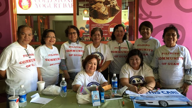 Officers and volunteers from the Filipino Community of Guam sell raffle tickets at the Guam Premier Outlets on Feb. 6, front row: Edna Rebanal, Demi Robinson, back row: Nick Caasi, Lynda Caasi, Beth Cena, Nilfa Milan, Blanca Imbo, Annabelle Dancel and Gloria Baguinon.
