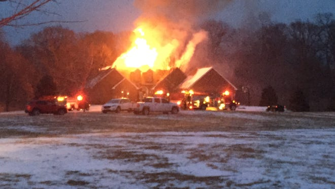 A fire rages in at a house in the 900 block of Jill Lane in western Tippecanoe County Monday, February 15, 2016.