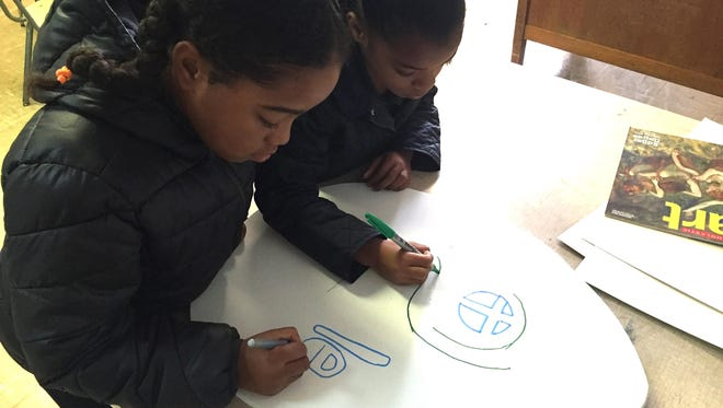 Students at Southwest Elementary work on an art exhibit in 2016.