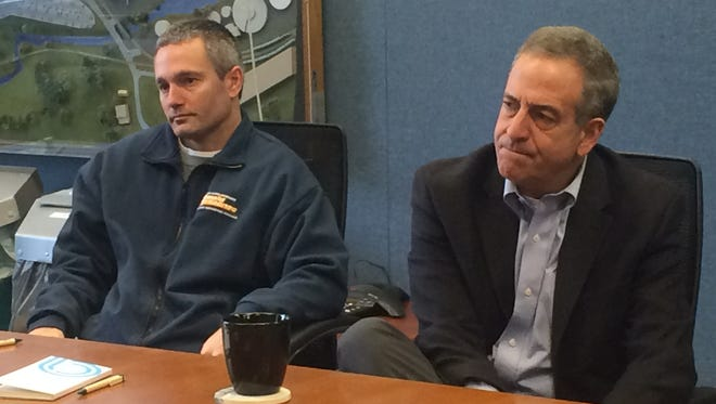 Democratic Senate candidate Russ Feingold (right) listens Monday to business leaders from Appleton Coated in Combined Locks.