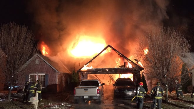 Discarded fireplace ash ignited a blaze that destroyed a southeast side home.