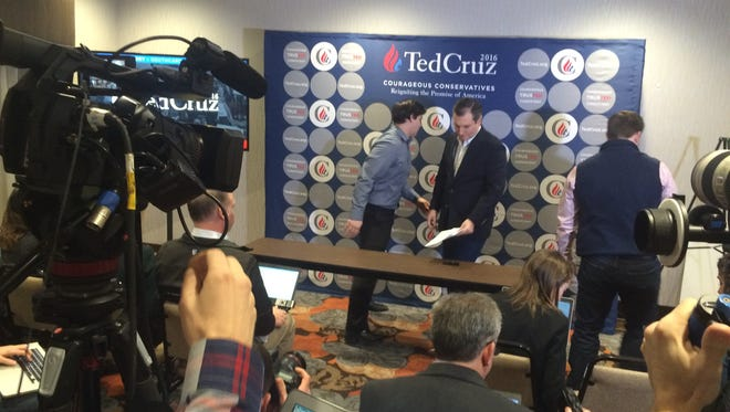 Republican presidential candidate Ted Cruz gets ready to talk to reporters Wednesday at the Hampton Inn & Suites in Seneca.