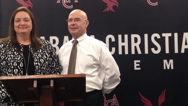 Misty Overman, left, introduces ACA's new athletic director, Scott Galloway, right during a press conference Wednesday.