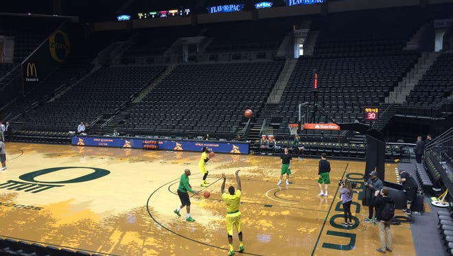 Oregon players warm up Saturday night before the Civil War game at Matthew Knight Arena.