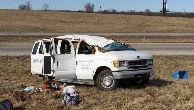 An overturned church van in eastern Springfield.